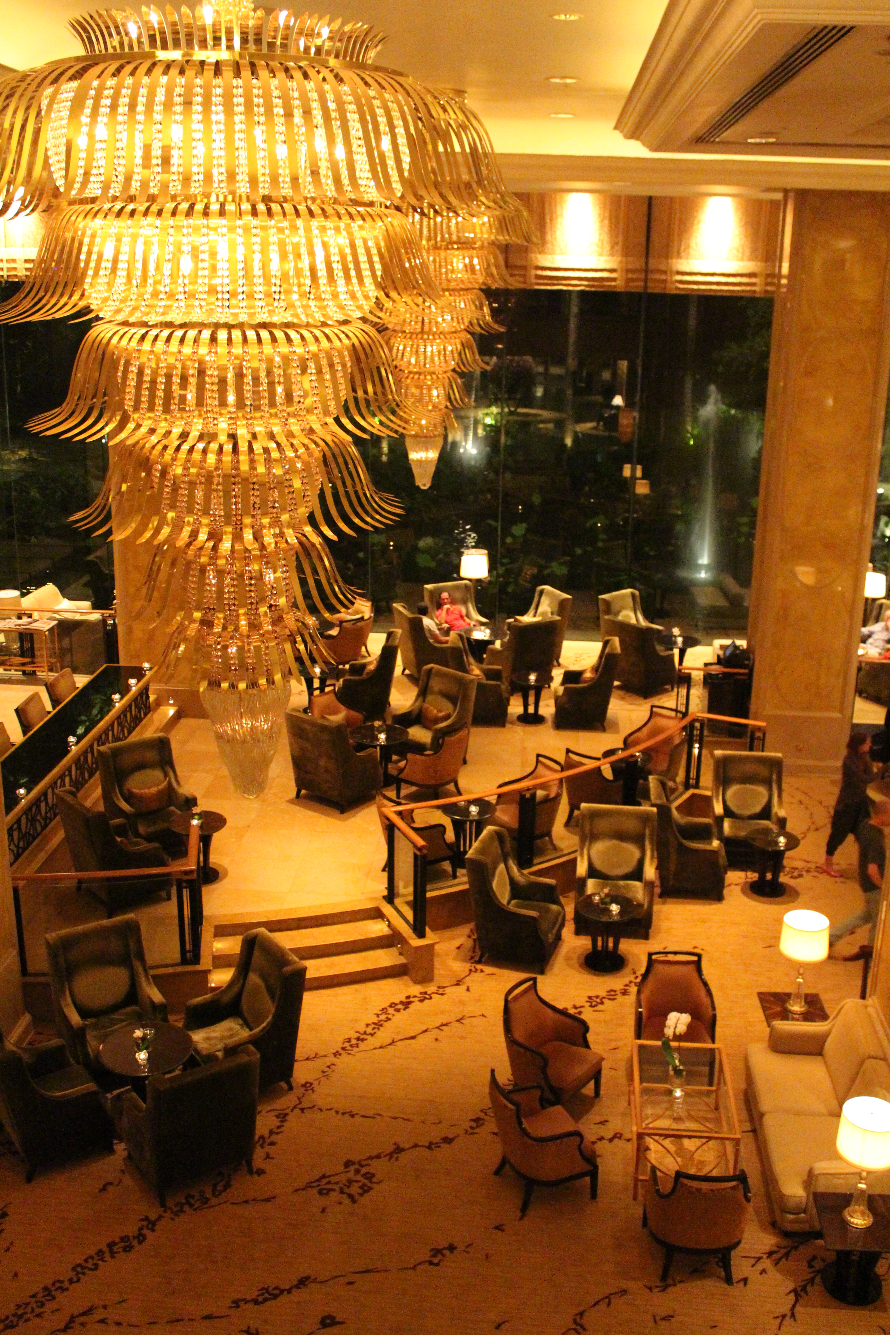 Lounge at the Shangri La Hotel in Kuala Lumpur with a 6 tiered funnel chandelier.